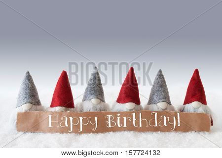 Label With English Text Happy Birthday. Christmas Greeting Card With Gnomes. Silver Background With Snow.