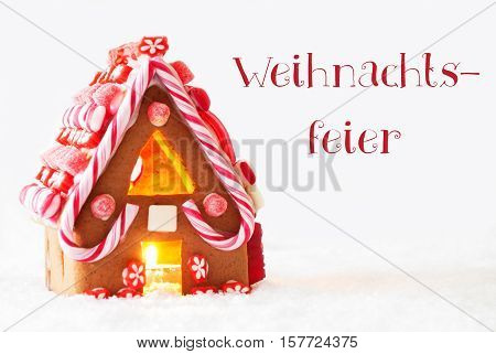 German Text Weihnachtsfeier Means Christmas Party. Gingerbread House In Snowy Scenery As Christmas Decoration With White Background. Candlelight For Romantic Atmosphere.