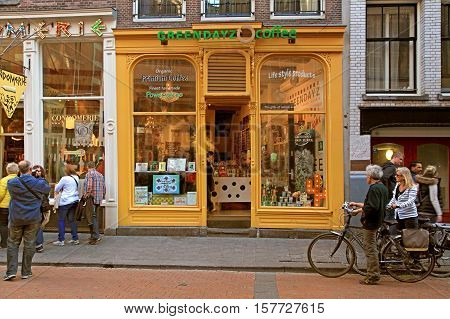 AMSTERDAM, NETHERLANDS - MAY 5, 2016: Coffeeshop exterior in the street of Amsterdam, Netherlands