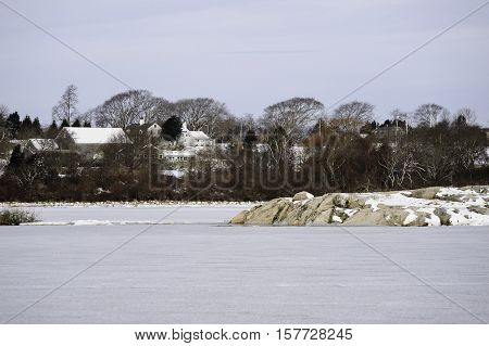 Dartmouth Massachusetts USA - February 13 2010: Winter scene Timmy's Rock on frozen Allens Pond in Dartmouth Massachusetts