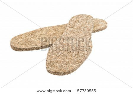 Felted insoles for shoes on white background