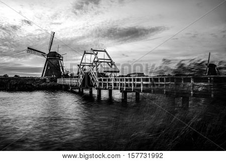 House inside windmill building on sunset in Kinderdijk Holland. Black-white photo.