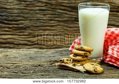 still life cookies chocolate chip raw food fresh milk and sweet biscuit wood background