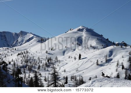 Mountain Top With Snowmobile Traces