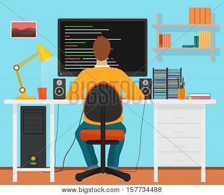 Man programmer back working on his PC computer. Coding and programming. Office interior programmer