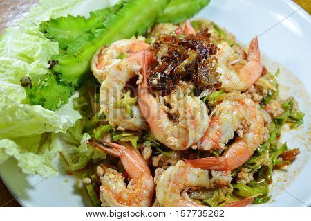 spicy shrimp and wing bean salad eat with fresh vegetable on dish