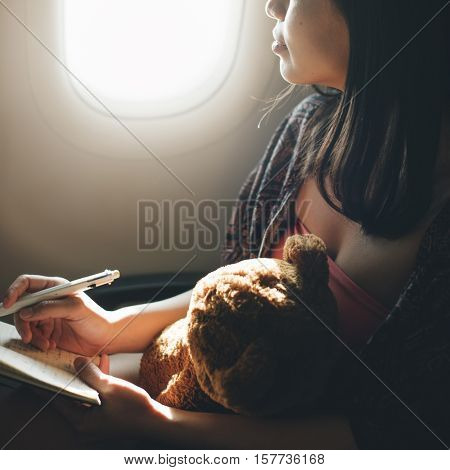 Woman Writing Notebook Plane Flying Concept