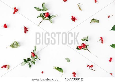 floral frame with minimal creative berry arrangement pattern on white. flat lay top view. christmas background wallpaper.
