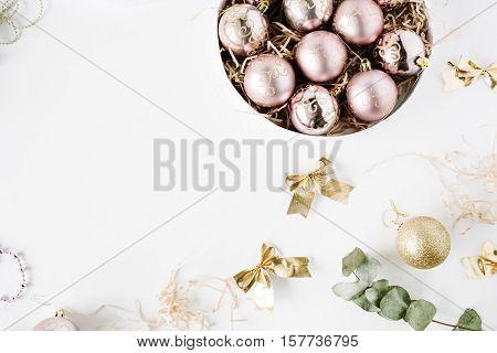 frame made of christmas decoration with christmas glass balls tinsel bow eucalyptus. christmas wallpaper. flat lay top view