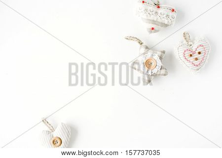 creative arrangement of handmade knitted christmas toys on white background. flat lay top view