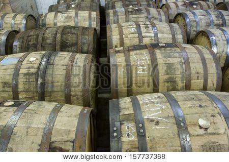 Used oak barrels in bottling facility of Kentucky distillery.