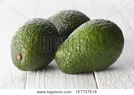Group of fresh avocados on a white background