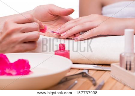 Hand manicure treatment in health concept