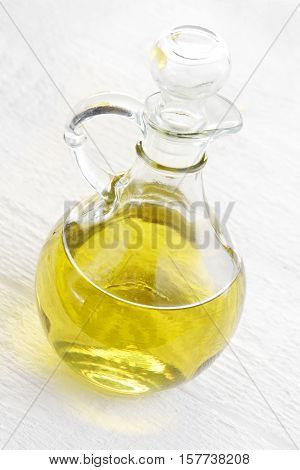 Glass bottle of vegetable oil on a white background