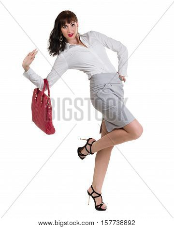 Caucasian business woman standing and holding handbag, full length portrait isolated on white background.