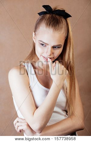 young pretty happy smiling blonde woman close up warm colors, lifestyle real people concept