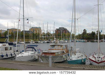 Boats docked along the pier and shoreline in Copenhagen Denmark on the Baltic Sea