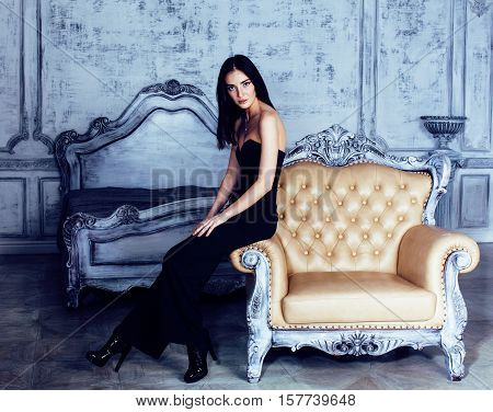 beauty young brunette woman in luxury home interior, fairy bedroom grey stylish close up