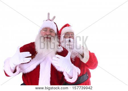 Two Santa's pose and argue about who the