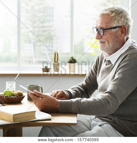 Senior Adult Using Digital Device Tablet Concept