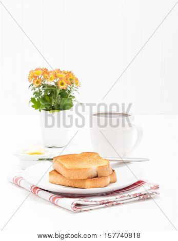 Two slices of white toast served with fresh brewed coffee.