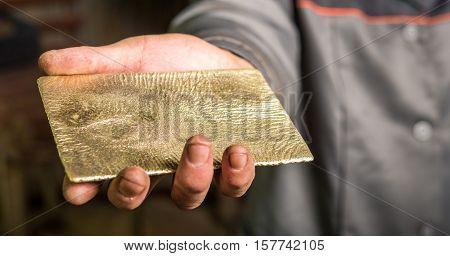 New shiny golden ingot at a factory