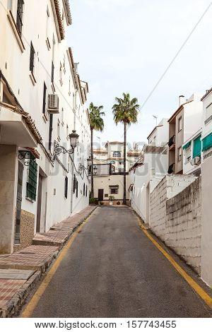 Narrow street in andalusian town Estepona. Costa del Sol Spain