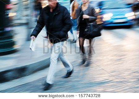 People Walking In The City At Dusk