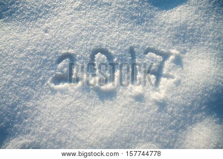 abstract New Year's and Christmas background .text on snow 2017