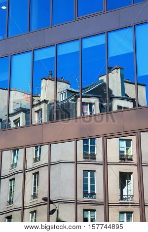 Old Building Reflects In Windows In Paris