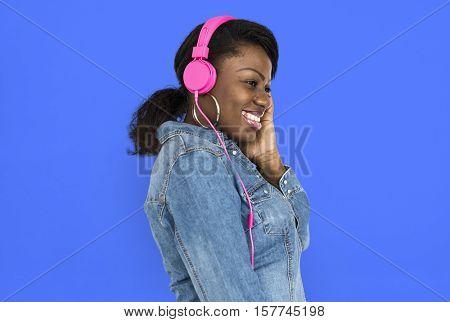 African Female Listening Music Headphone Concept