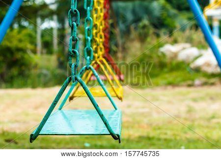 Empty chain swing in playground public park.