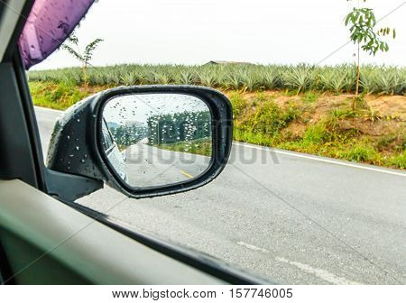 Landscape in the sideview mirror of a car, on road countryside, natural