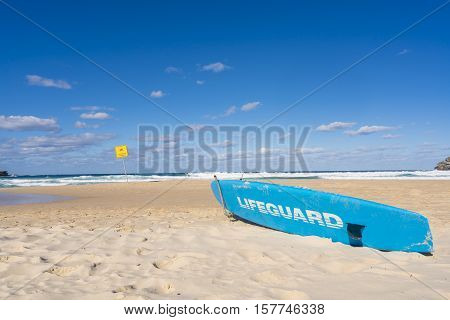 Lifeguard surfboard on beach at Sydney, Australia during daytime