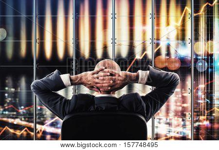 Businessman watching a virtual widescreen of business analysis