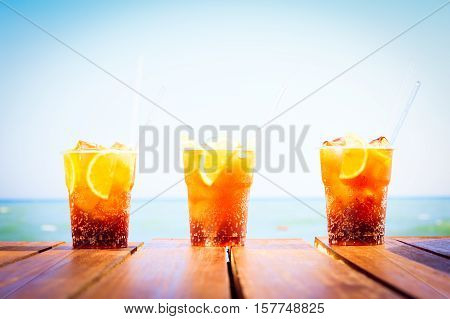 Concept Of Luxury Tropical Vacation. Three Cuba Libre Cocktails On The Pier