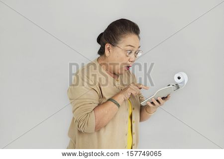 Senior Adult Women Hold Calculator Concept
