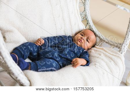 Portrait of a cute mixed race baby.