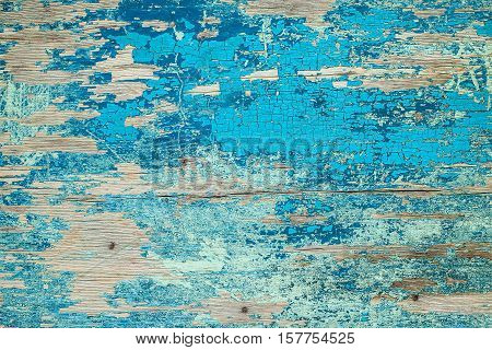 Blue wooden background with crackling effect. High resolution. Copy space. Top view