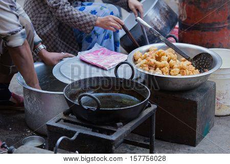 fried nepali food selling at street shop