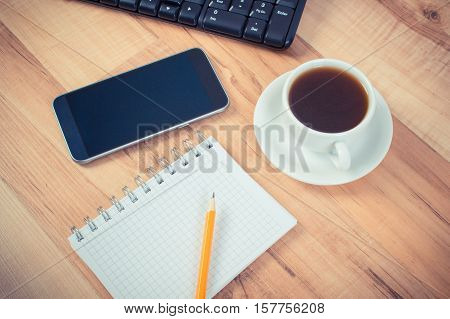 Vintage Photo, Mobile Phone With Notepad For Writing Notes And Cup Of Coffee