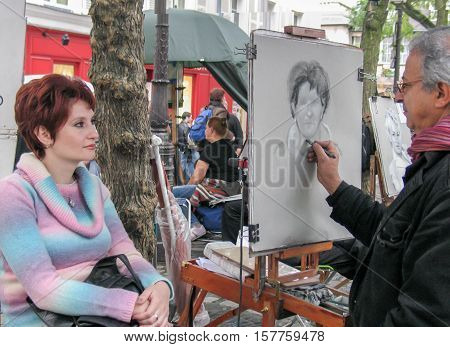 PARIS, FRANCE - NOVEMBER 28, 2006: Place du Tertre in Montmartre: Artists easels and artwork.