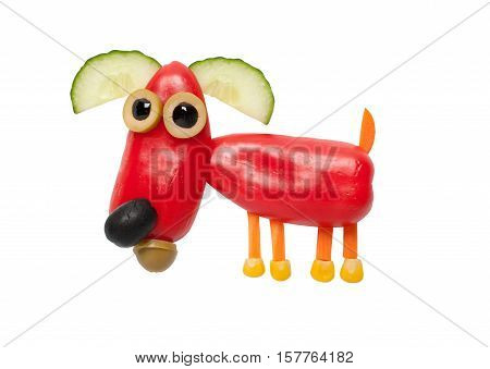 Funny dog made of red pepper on isolated background