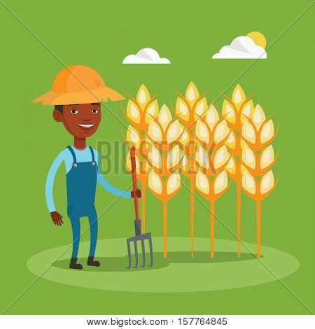 An african farmer in summer hat standing with pitchfork on the background of wheat field. Farmer holding agricultural tool and working in wheat field. Vector flat design illustration. Square layout.