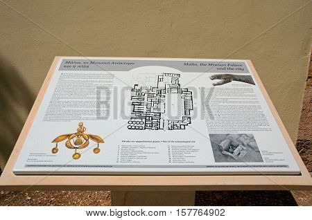 MALIA, CRETE - SEPTEMBER 14, 2016 - Information sign for the Palace of Malia Minoan ruins site showing the golden bee pendant Malia Crete Greece Europe, September 14, 2016.