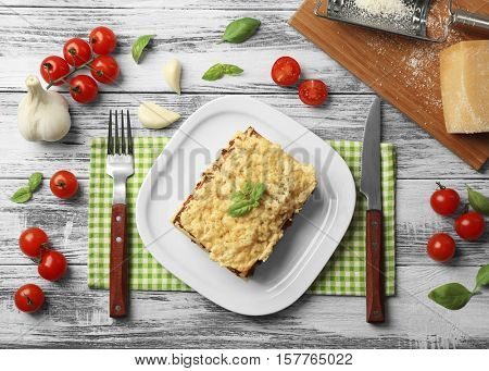 Tasty homemade meat lasagna on wooden table, top view