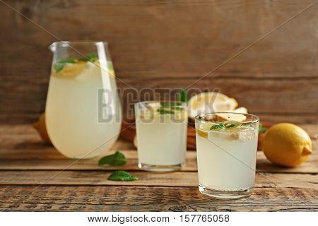 Glasses of refreshing lemonade on table
