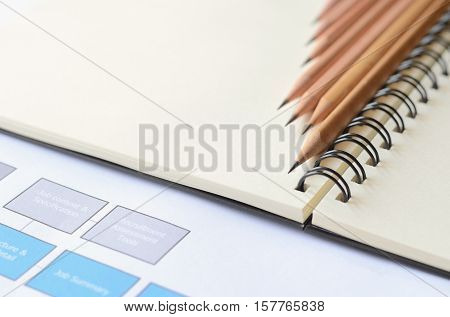 Wooden pencils on blank note book with copy space,use for backdrop or add your text.