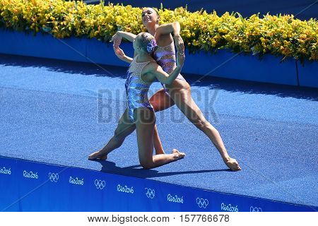 RIO DE JANEIRO, BRAZIL - AUGUST 14, 2016: Anita Alvarez and Mariya Koroleva of team United States compete during synchronized swimming duets free routine preliminary of the Rio 2016 Olympic Games