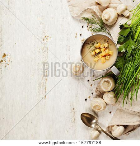Creamy Mushroom Soup on white rustic background
